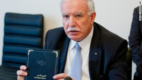 Palestinian Foreign Minister Riad Malki participates in a ceremony marking Palestinian membership in the International Criminal Court in The Hague, Netherlands, Wednesday, April 1, 2015.
