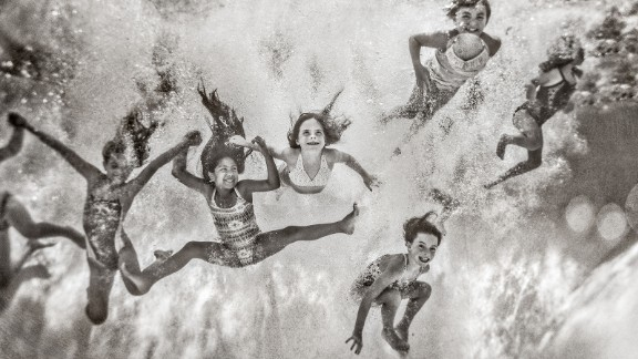 """Parker shot this image while her best friend held her underwater. """"My best friend and I played soccer together in college and coach together now,"""" Parker said. """"I want my girls to be like these girls that I grew up with in college."""""""