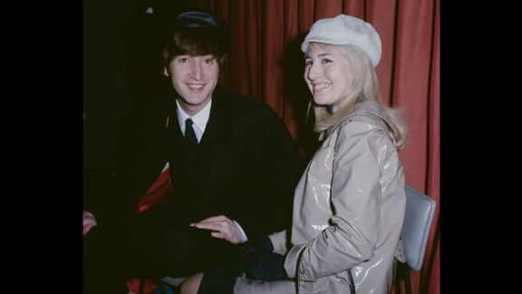John and Cynthia Lennon are seen at an airport in London before a flight to New York in 1964. They were married from 1962-1968.