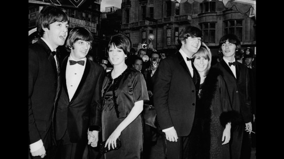 """From left, Paul McCartney; Ringo Starr and his wife, Maureen; John and Cynthia Lennon; and George Harrison pose for photographers at the London premiere of Dick Lister's film """"Help"""" in July 1965."""