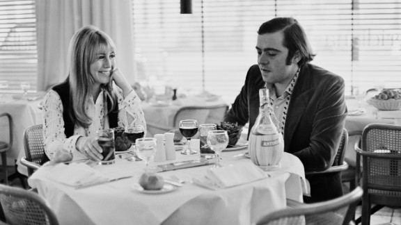 Lennon and Italian hotelier Roberto Bassanini dine together at a restaurant in 1969. They were married in 1970.