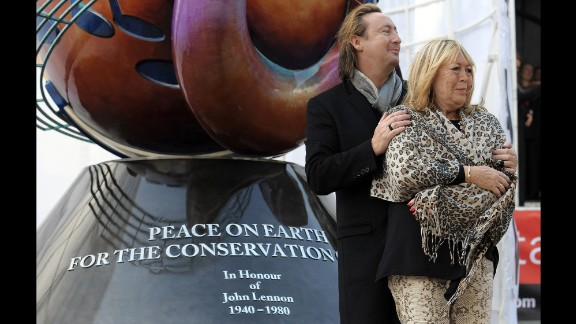 Julian and Cynthia Lennon unveil a European peace monument dedicated to the memory of John Lennon in Liverpool, England, in October 2010. The monument celebrated what would have been John Lennon's 70th birthday.