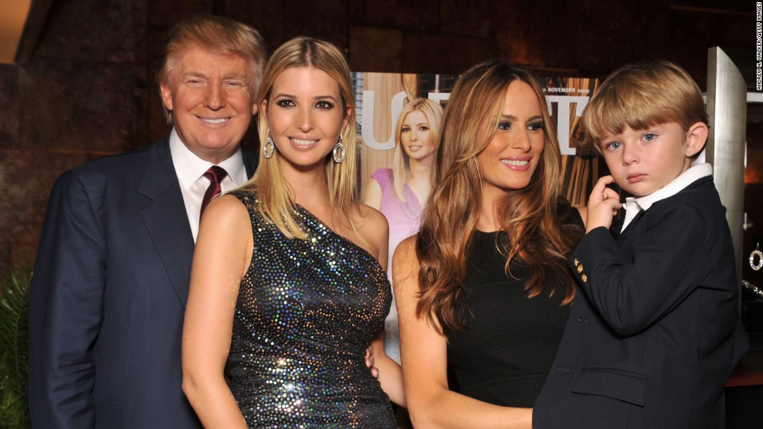 "Trump, his daughter Ivanka, wife Melania and son Barron attend the ""The Trump Card: Playing to Win in Work and Life"" book launch celebration at Trump Tower on October 14, 2009, in New York City."
