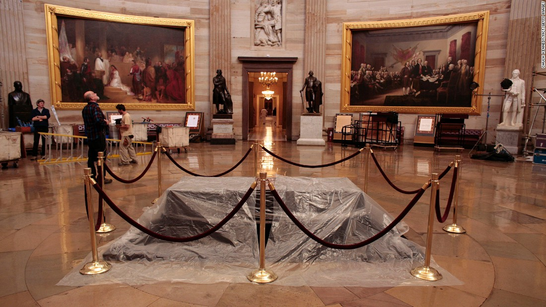 "A plastic sheet shrouds <a href=""http://www.aoc.gov/nations-stage/catafalque"" target=""_blank"">the catafalque</a>, or platform, originally built to support the casket while the President lay in state in the U.S. Capitol Rotunda. It has been used often for dignitaries and elected officials since. Here, it is prepared for honors to former President Gerald Ford in December 2006. The catafalque is normally displayed in the Exhibition Hall at the <a href=""http://www.visitthecapitol.gov/"" target=""_blank"">U.S. Capitol Visitor Center</a>. The black drapery on top of the wooden platform has been changed several times over the years."