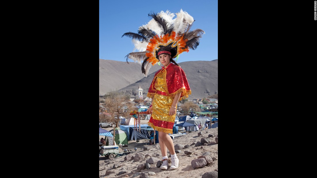 Pricila Encalada wears a colorful headdress in San Lorenzo de Tarapaca.