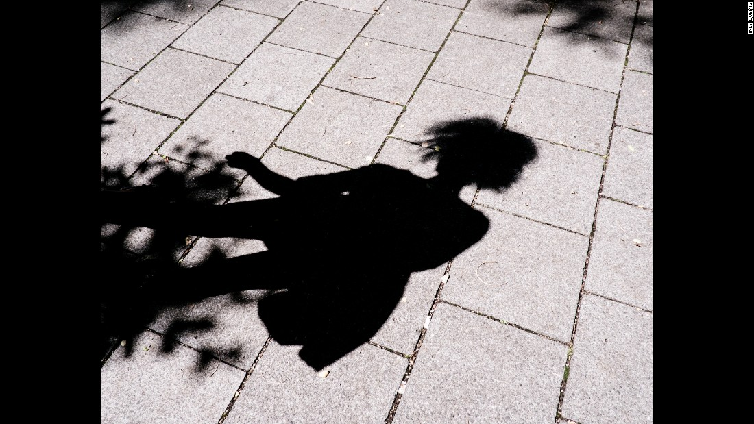 Sahra's shadow is seen on the ground.