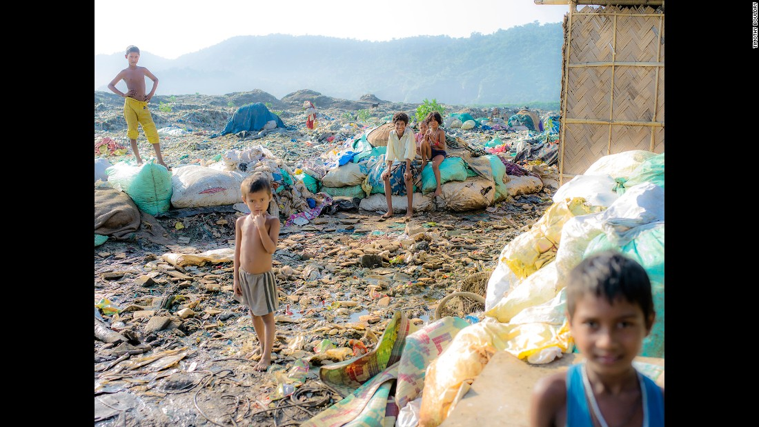 The families at the landfill live directly on top of mountains of trash. Walking around is difficult because it is all wet, dirty trash, and some of it sinks deeper then others. So the children are usually barefoot or wear sandals.