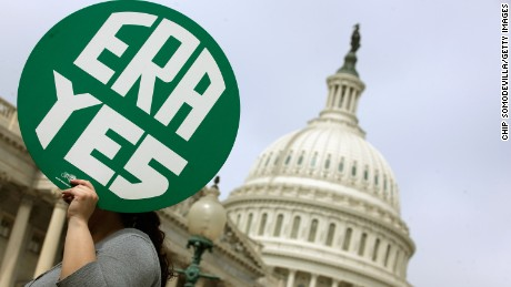 Caption:WASHINGTON, DC - MARCH 22: A woman hold up a sign as members of Congress and representatives of women's groups hold a rally to mark the 40th anniversary of congressional passage of the Equal Rights Amendment (ERA) outside the U.S. Capitol March 22, 2012 in Washington, DC. Rep. Carolyn Maloney (D-NY) and Sen. Robert Menendez (D-NJ) introduced a new version of the Equal Rights Amendment last year and called for it to be passed again. (Photo by Chip Somodevilla/Getty Images)