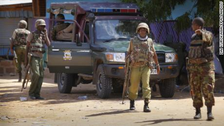 Kenyan soldiers stand guard in front of Garissa University College in Kenya on Thursday, April 2.