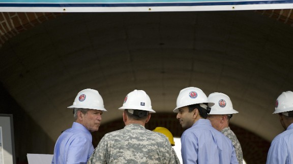 Jindal tours reconstruction efforts at Jackson Barracks, the headquarters of the Louisiana National Guard, with then-President George W. Bush on August 20, 2008.