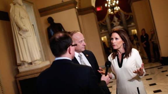 Rep. Michele Bachmann, R-Minnesota, right, and Rep. Steve King, R-Iowa, center, talk with a reporter at the U.S. Capitol as the House of Representatives continues a temporary recess on December 11, 2014, during her last month in office. Here