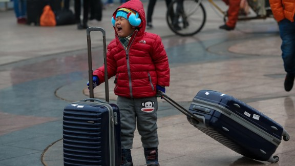 BEIJING, CHINA - FEBRUARY 28: A child cries as he waits his mother at Beijing Railway station on February 28, 2015 in Beijing, China.  (Photo by Emmanuel Wong/Getty Images)