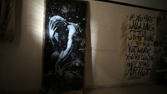 A mural of a weeping woman, painted by the British street artist Banksy, is seen in Khan Yunis, Gaza, on Wednesday, April 1. The mural was painted on a door of a house destroyed last summer during the fighting between Israel and Hamas. The owner of the house said he was tricked into selling the door for the equivalent of $175, not realizing the painting was by the famously anonymous artist.