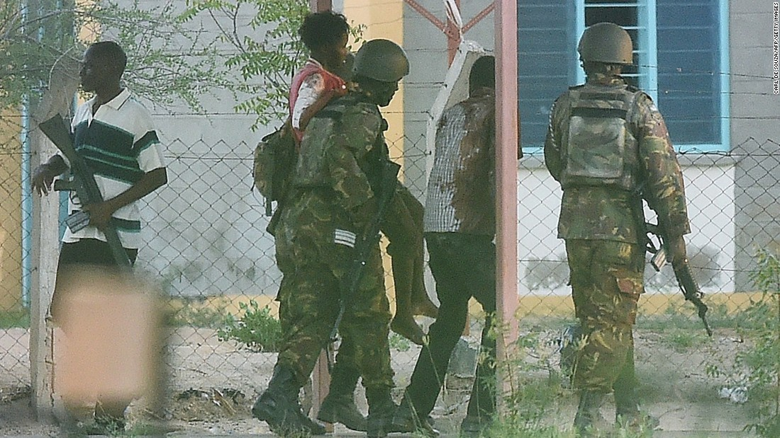 A student hostage is escorted out of the school after troops ended the gunmen's siege on April 2, 2015.