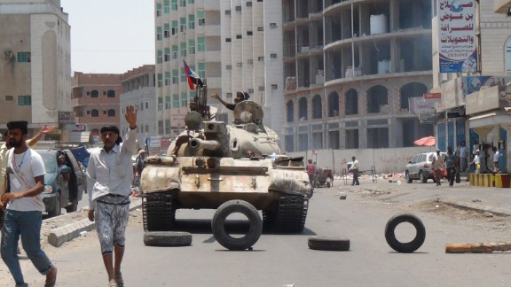 Militiamen loyal to Hadi take positions on a street in Aden, Yemen, on Thursday, April 2. Houthi rebels seized the presidential palace in Aden, a neutral security official and two Houthi commanders in Aden told CNN. The Houthis are Shiite Muslims who have long felt marginalized in the majority Sunni country. The Sunni Saudis consider the Houthis proxies for the Shiite government of Iran and fear another Shiite-dominated state in the region.