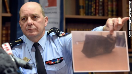 French Gen. David Galtier holds up a picture of the second black box from downed Germanwings Flight 9525 during a press conference in Marseille, France, on Thursday, April 2. The flight data recorder shows that the co-pilot purposely used the controls to speed up the plane's descent, investigators said.