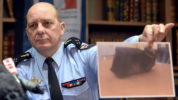 French Gen. David Galtier holds up a picture of the second black box from Germanwings 9525 during a news conference in Marseille, France, on Thursday, April 2. The flight data recorder shows that co-pilot Andreas Lubitz purposely used the controls to speed up the plane