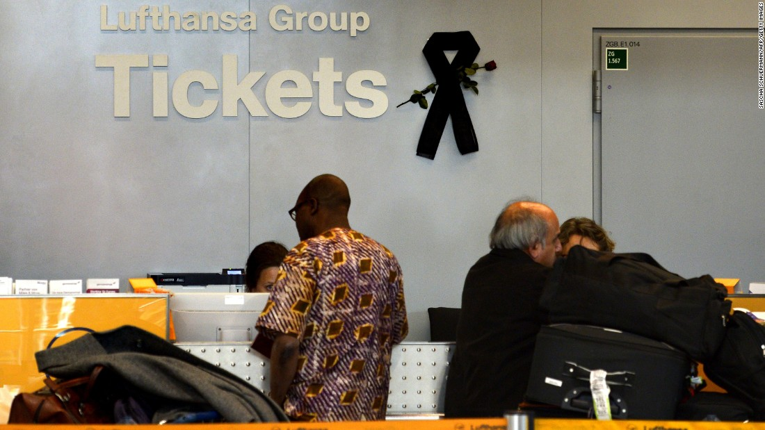 A black mourning band is seen at a ticket counter for German airline Lufthansa at the airport in Dusseldorf, Germany, on Tuesday, March 31.