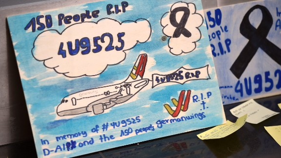 Messages for the victims are displayed at the airport in Dusseldorf on March 31.