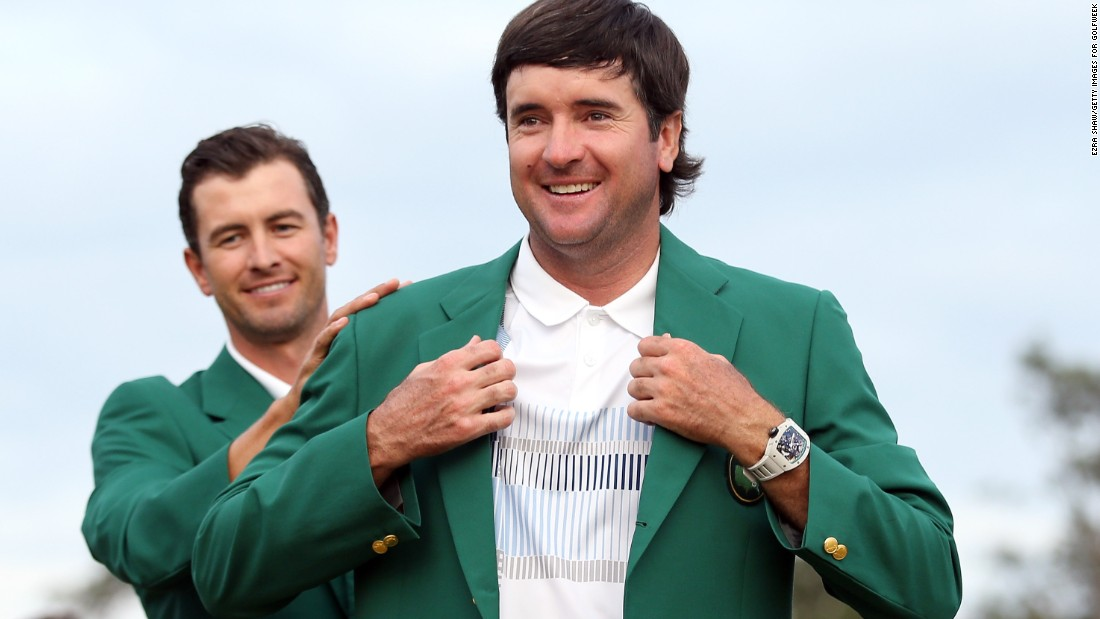 Bubba Watson won his second Masters title in 2014. The previous year's winner, Adam Scott, helped Watson into the jacket, as per tournament tradition.