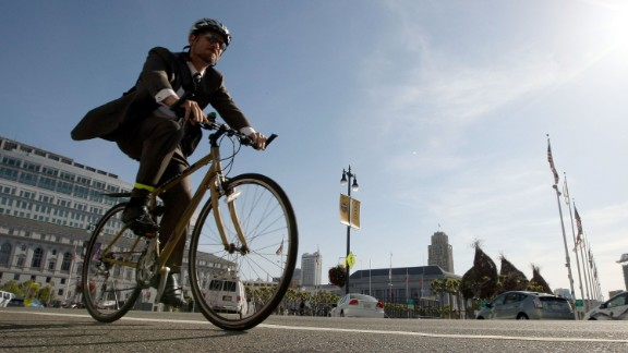 A bicyclist rides his bike down Polk Street on Bike to Work Day May 14, 2009 in San Francisco, California.