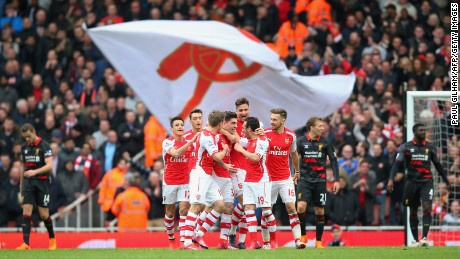 Arsenal players celebrate Hector Bellerin's opener against Liverpool.