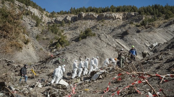 A recovery crew works among debris of Germanwings Flight 9525 at the crash site near Seyne-les-Alpes, France, on Friday, April 3. The crash killed all 150 people aboard and has raised questions about the co-pilot