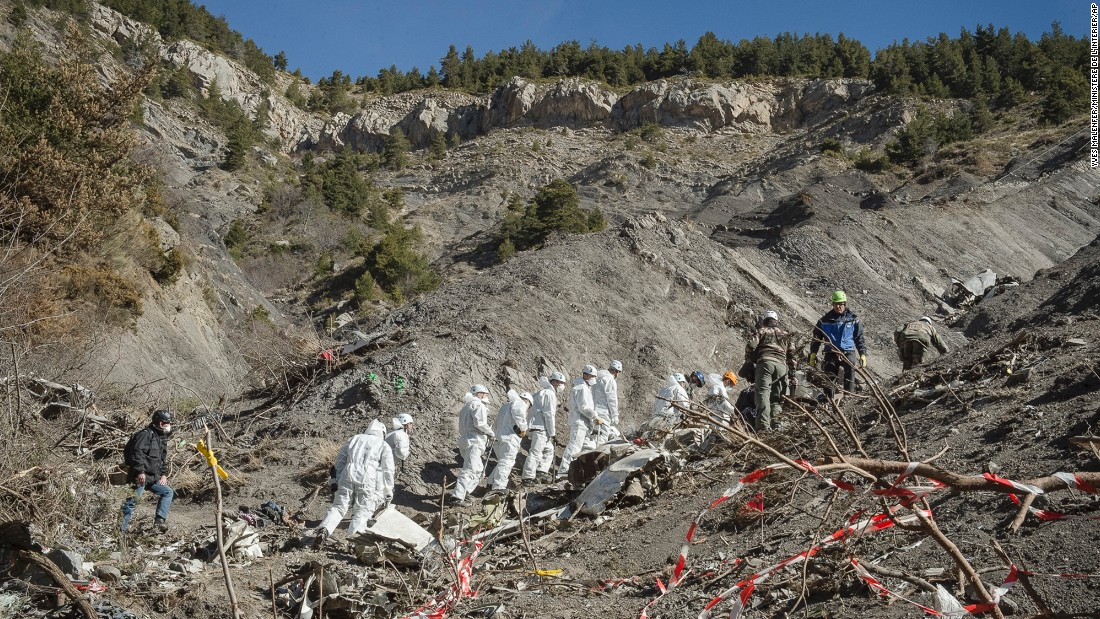 A recovery crew works among debris of Germanwings Flight 9525 at the crash site near Seyne-les-Alpes, France, on Friday, April 3. The crash killed all 150 people aboard and has raised questions about the co-pilot's mental state.