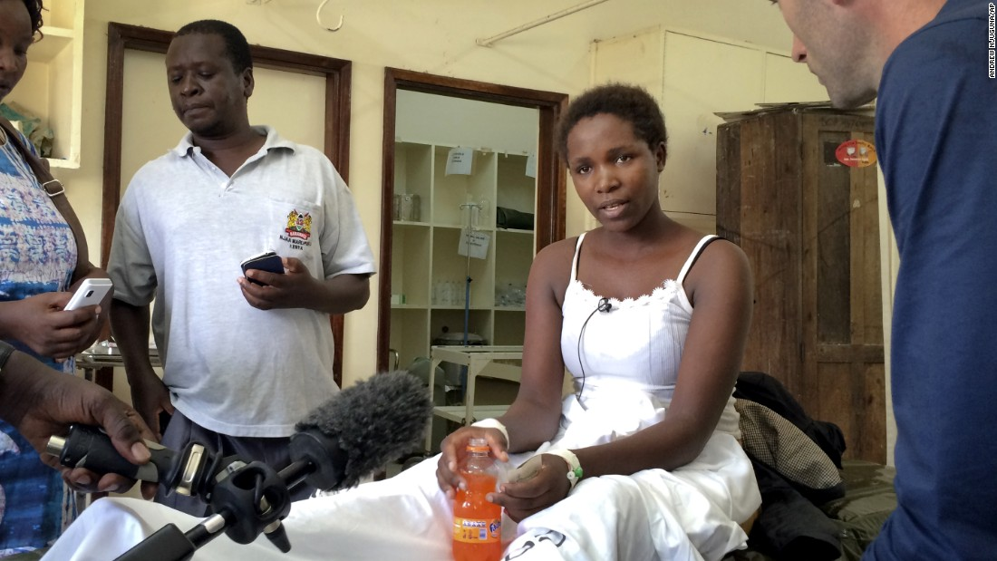 Survivor Cynthia Cheroitich speaks to a television reporter at a hospital ward in Garissa on April 4, 2015. Cheroitich told CNN she hid in a closet, covering herself.