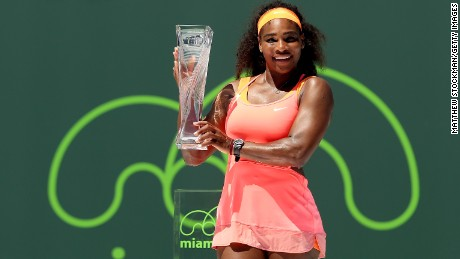 Serena Williams poses after winning the Miami WTA Open.