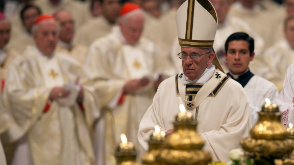 Pope Francis celebrates an Easter vigil service in St. Peter's Basilica.