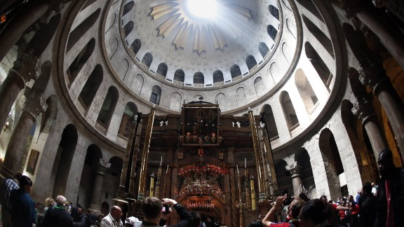 Catholic worshipers visit the Holy Sepuchre Church during the Good Friday ceremony on April 3, 2015 in Jerusalem's Old City.