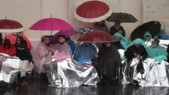 The faithful came well equipped to deal with the weather as they waited for Pope Francis.