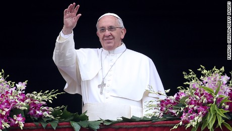 Pope Francis waves to the faithful as he delivers his 'Urbi et Orbi' blessing message from the central balcony of St Peter's Basilica at the end of the Easter Mass on April 5 in Vatican City, Vatican.