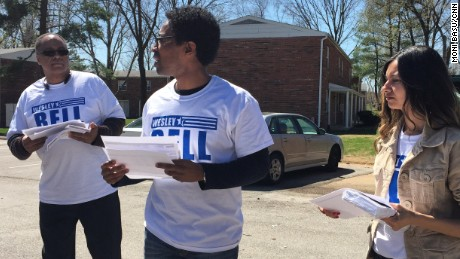 Wesley Bell, center, campaigns near Canfield Drive, where Michael Brown was killed in August.