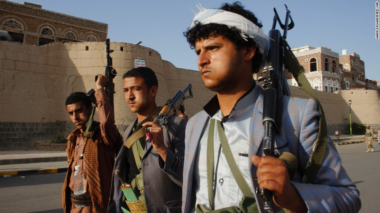 Houthi rebels carry weapons during a protest in Sanaa, Yemen, on April 1.