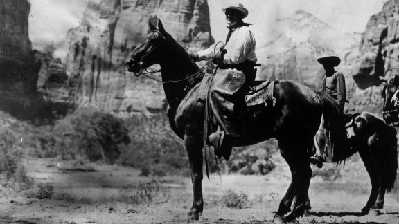 """Harding dresses as a cowboy for a presidential party in the West in July 1923. Harding also used the slogan """"Cox and cocktails,"""" a jab at his anti-Prohibition opponent, in 1920."""