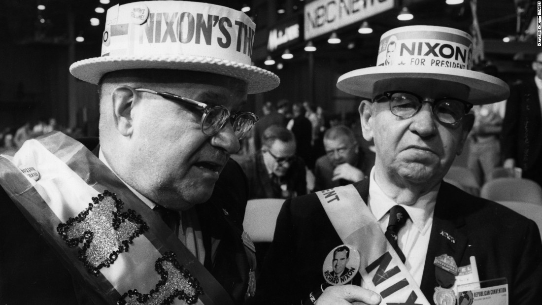 "Two supporters of Richard Nixon attend the Republican National Convention on August 9, 1968, in Miami Beach, Florida, where Nixon was nominated Republican presidential candidate. His campaign slogan was, ""Nixon's the One."""