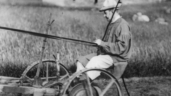 Coolidge mows his father