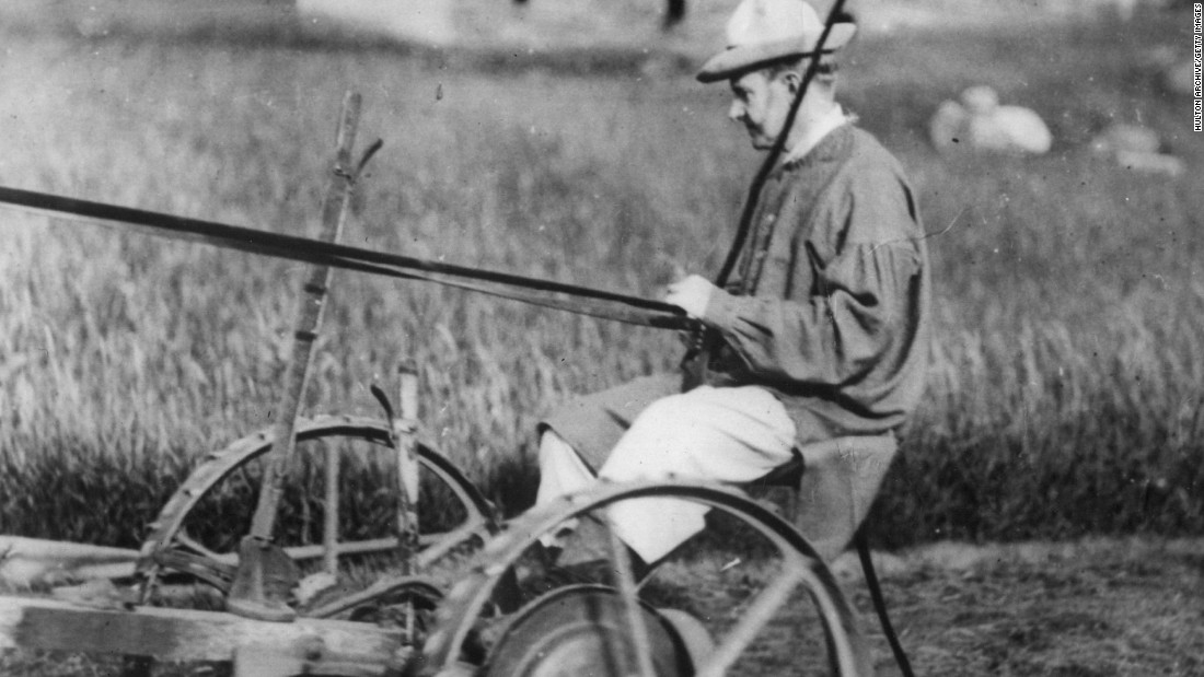 "Coolidge mows his father's farm in Plymouth, Vermont, circa 1920. Coolidge used the slogan ""Keep cool with Coolidge"" in 1924."