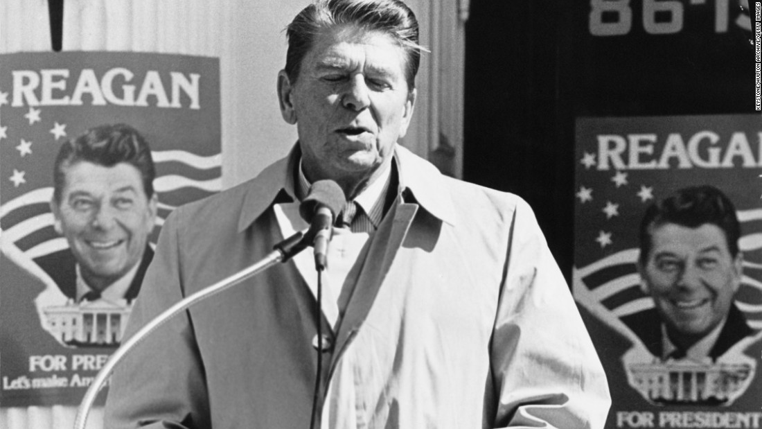 "Reagan makes a speech during the Republican presidential primary in New York in March 1980. Behind him are campaign posters with one of his most famous slogans: ""Let's make America great again."""