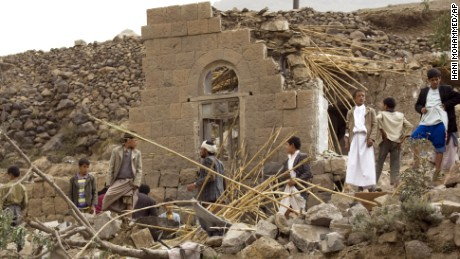 Yemenis gather as they search for survivors in the rubble of houses destroyed by Saudi-led airstrikes in a village near Sanaa, Yemen, Saturday, April 4, 2015. Since their advance began last year, the Shiite rebels, known as Houthis have overrun Yemen's capital, Sanaa, and several provinces, forcing the country's beleaguered President Abed Rabbo Mansour Hadi to flee the country. A Saudi-led coalition continued to carry out intensive airstrikes overnight and early Saturday morning targeting Houthi positions.