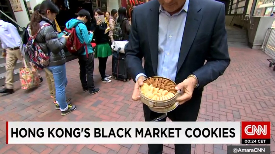 CNN's Andrew Stevens tries Hong Kong's latest sensation -- Jenny's butter cookies. Tourists and locals queue up for hours to get their hands on a tin.