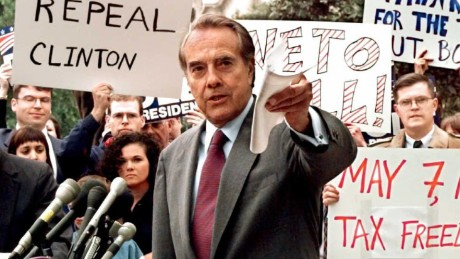 "Republican presidential candidate U.S. Senator Bob Dole (center) pushes for a repeal of the 4.3 cent gas tax during a rally in front of the Internal Revenue Service, as he campaigned against President Bill Clinton. Dole's campaign slogan was ""The Better Man for a Better America."""