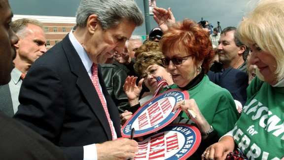 """John Kerry signs """"The Real Deal"""" campaign posters for supporters after a rally on April 27, 2004, in Youngstown, Ohio."""