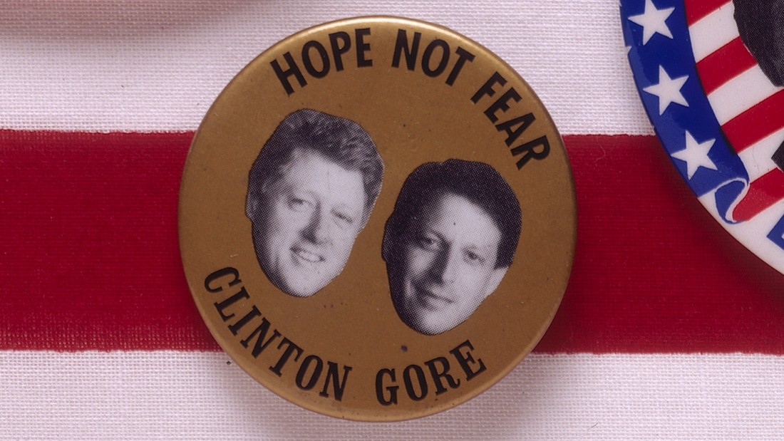 "A badge for the 1992 presidential election features Democratic candidates Bill Clinton and Al Gore with the slogan ""Hope not fear."""