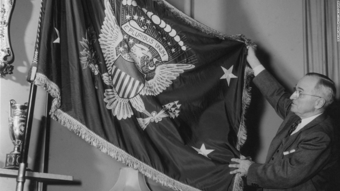 "Truman holds a flag bearing the Seal of the United States, circa 1945. Truman used the slogan, ""I'm just wild about Harry."""