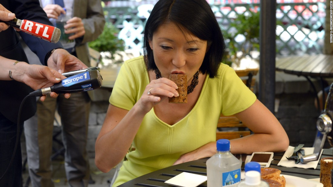 "In addition to cronuts, Ansel's other creation -- the ""cookie shot"" -- also went viral. A chocolate chip cookie is baked in the shape of a shot glass and then filled with vanilla-infused milk. Here, the French Trade Minister Fleur Pellerin takes a taste of the ""cookie shot"" during her trip to New York."
