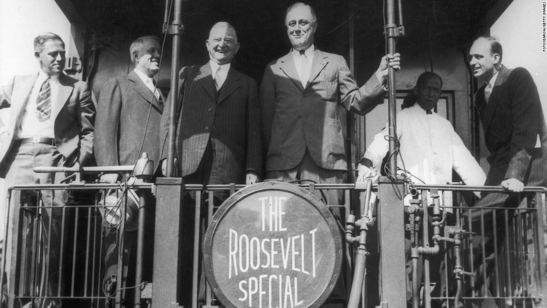 "President Franklin D. Roosevelt and his colleagues pose aboard ""The Roosevelt Special"" campaign train on September 14, 1932. When Roosevelt ran for president eight years later, he used the slogan, ""Better a third-termer than a third-rater."""