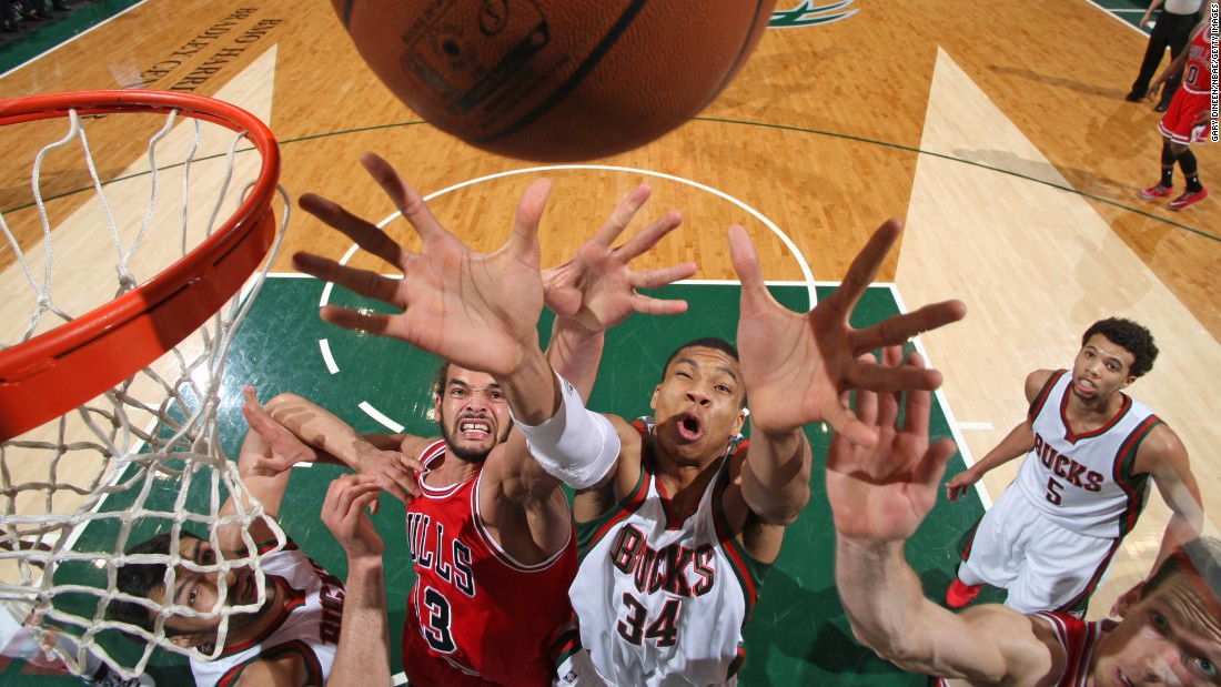 Milwaukee's Giannis Antetokounmpo (No. 34) reaches for a rebound while playing the Chicago Bulls in an NBA game Wednesday, April 1, in Milwaukee.